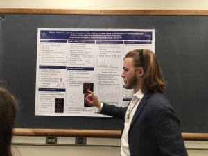Will Smith presents his first place poster at the 2019 Undergraduate Poster Session in the Duke Physics Department.